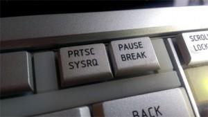 PRTSC - press to take a screen capture